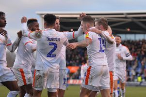 Town celebrate James Collins' making it 3-0 at Shrewsbury on Saturday