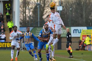 James Justin heads clear against Shrewsbury