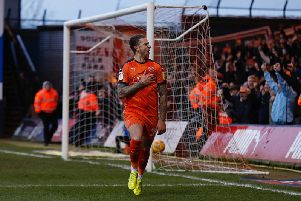 George Moncur wheels away after putting Luton 2-0 in front against Wycombe
