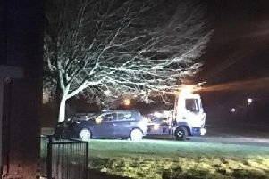 The car pictured after hitting the tree yesterday evening.