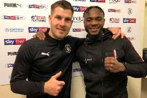 Linus Udofia with Luton Town striker James Collins