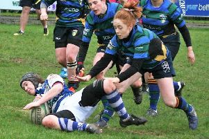 Laura Saunders scores a try for Dungannon