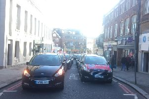 Minicab drivers are going slow in protest of the conditions working for Addison Lee. They have been going slow from the Luton Airport roundabout to George Street, they are now protesting outside the Town Hall, calling for the council to enforce legal workers rights for drivers