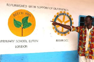 Lamin Saidy points to the Beech Hill twinning sign.