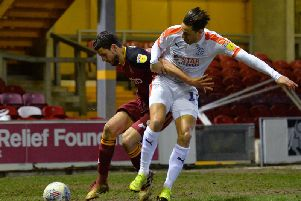 Harry Cornick makes a challenge in Tuesday night's 1-0 win at Bradford