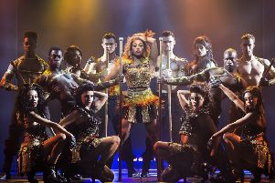 Alexandra Burke (centre) as Rachel Marron in The Bodyguard