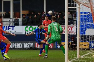 Hatters striker James Collins gets a header in against Gillingham