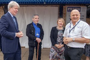 Earl Spencer, Phil Houston, Beverley Horner and Rob Kinning picture before the shop window is unveiled