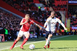 Elliot Lee tries to put a Charlton opponent under pressure