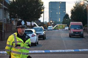 Police at the scene in Wolverhampton where a six-year-old boy was injured when a group of men opened fire on a house with a shotgun. Picture: Matthew Cooper/PA Wire