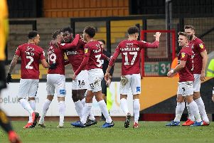 Cobblers celebrate Aaron Pierre's goal at Cambridge