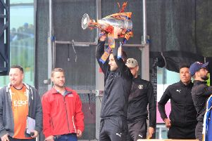 Andrew Shinnie lifts the League One trophy