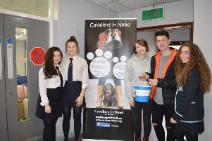 Year 13 students Lauren Redmond, Victoria Kernaghan, Charis Stockley Marana McLoughlin and Max Gregg pictured at the Puppy Petting Day