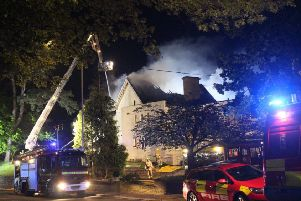 Firefighters tackle a fire at the former Mount Denys Care Home in The Ridge SUS-190519-160051001