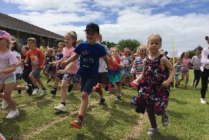 Race for Life at Durrington Infant and Junior Federated Schools, including a competition to find the most colourful class