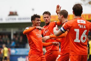 James Justin celebrates a goal during his time with Luton