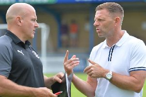 Hatters boss Graeme Jones in discussion with assistant Gary Brabin