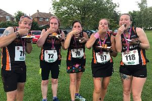 Runners enjoy the post-race cake in Sleaford. F3FJ0ySWrWc4W1tK8LMF