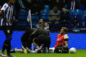 Martin Cranie receives treatment against Sheffield Wednesday