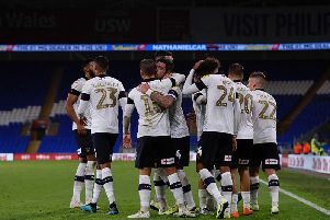 Luton Town reached the third round by beating Cardiff City last night
