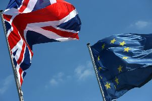A British Union Jack and European Union flag fly SUS-190124-085814001