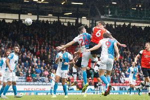 Matty Pearson heads home the winning goal at Blackburn Rovers this afternoon