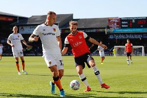 Andrew Shinnie is back in the side to face brother Graeme this afternoon