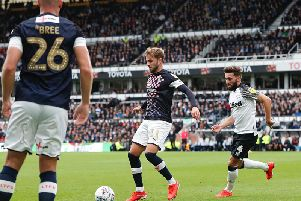 Andrew Shinnie shields the ball from brother Graeme in Town's 2-0 defeat at Derby last weekend