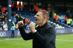 Town chief Graeme Jones celebrates his side's 3-0 win over Bristol City on Saturday