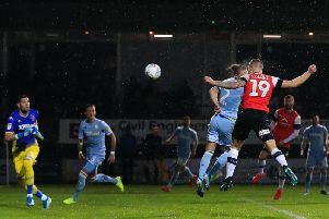James Collins heads home his sixth of the season for Luton against Leeds on Saturday
