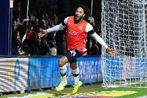 Izzy Brown celebrates opening his account for the Hatters last night