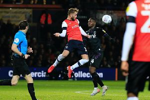 Andrew Shinnie wins a header against Charlton on Tuesday night
