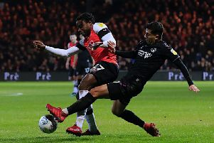 Pelly-Ruddock Mpanzu is challenged during Tuesday night's 2-1 win over Charlton