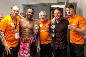 Linus Udofia celebrates after winning the English middleweight title.