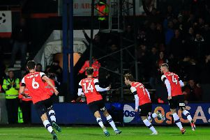 Callum McManaman sets off after levelling the scores for Luton on Saturday