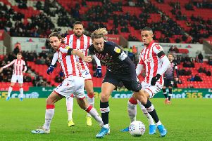 Harry Cornick looks to get away against Stoke