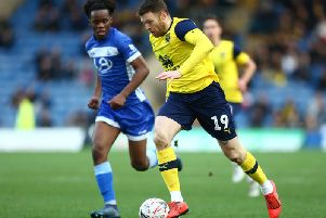 Peter Kioso tracks Oxford United's Jamie Mackie in the FA Cup third round defeat recently