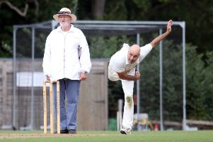 Great & Little Tew II bowler Joe Hummer sends down a delivery against Banbury III at Ledwell Road