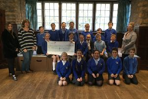 Staff from Spring Beauty Room visited the school to present a cheque for �210. EMN-180412-102111001