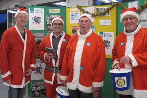 Santa shift change at Caistor: - Jo Bowman, Hugh Nott, Tony Maund and David Mason. EMN-181231-065816001