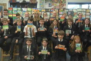 Some of the pupils who have created a postcard showing their favourite thing about Market Rasen EMN-190502-092340001