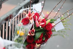 Flowers were tied to railings at Elm Grove, near the scene of the fatal stabbing
