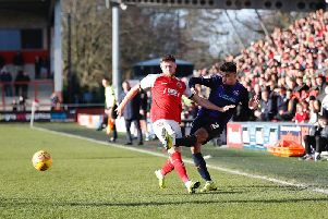 James Justin crosses the ball against Fleetwood on Saturday