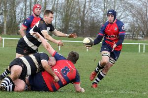 Banbury Bulls' Jacob Mills receives a pass from Callum Horne against Stratford Upon Avon at the DCS Stadium. Photo: Steve Prouse