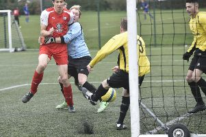 Action from a Peterborough League Division Two game between Netherton Reserves (yellow) and Spalding Athletic which the former won 2-0. Photo: David Lowndes.