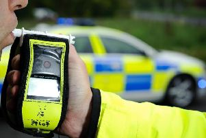 Police conduct a breath test on a suspected drink driver EMN-190322-115911001