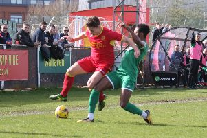Banbury United's George Nash takes on Biggleswade Town's Claudio Ofosu. Photo: Steve Prouse NNL-190323-161438002