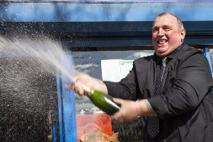 Paul Trollope from Horley celebrates his big win with a bottle of bubbly