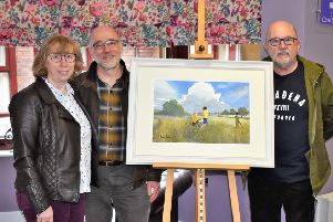 2018 Raffle winner Pauline Martin (left), husband Ian Martin and artist Dennis Nash (right) with painting.