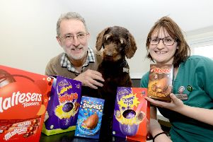 Boseley with owner Peter Hind and Eastfield Veterinary Hospital veterinary nurse Heather Sparks (RVN).